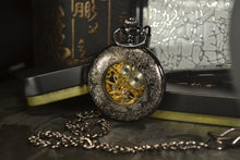 Load image into Gallery viewer, back of modern pocket watch with blue hands
