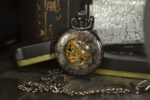 back of modern pocket watch with blue hands