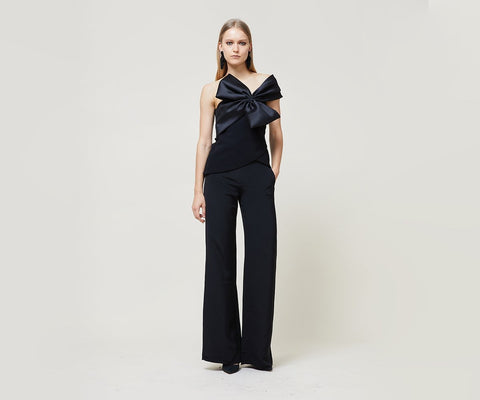 """Crepe one-shoulder top with draped satin bow around shoulder. Zips at side. """"Just a perfect top to make a statement at your next dinner party."""" -Jennifer Carrion, Technical Design Director Fabric: Jet knit, Bow: Jet stretch mikado <!-- td {border: 1px solid #ccc;}br {mso-data-placement:same-cell;} -->"""