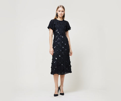 """<!-- td {border: 1px solid #ccc;}br {mso-data-placement:same-cell;} --> Cocktail dress with flutter sleeves and slightly flared skirt. Zips at back. Embroidered with paillettes in wave design. """"Such a fun spin on my LBD. A great way to stand out without stealing all of the attention."""" -Tatiana Ware, Associate Technical Designer Fabric: Jet silk georgette"""