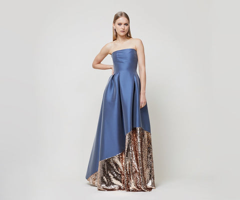 """Bodice has princess seams for snug fit, and skirt has box-pleats for fullness. Champagne sequined panel on skirt. Gown zips in back, has side pockets, and has silicone tape around inside of top to prevent slipping. """"The juxtaposition of the feminine rose gold sequins against the deep steel is a complete showstopper."""" -Jolanta Meckauskaite, Controller Fabric: Steel blue stretch mikado."""