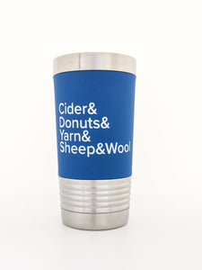 "Image shows a stainless steel tumbler wrapped with a removable silicone sleeve that has been laser engraved with the phrase ""Cider & Donuts & Yarn & Sheep & Wool"" in white letters on a royal blue background."