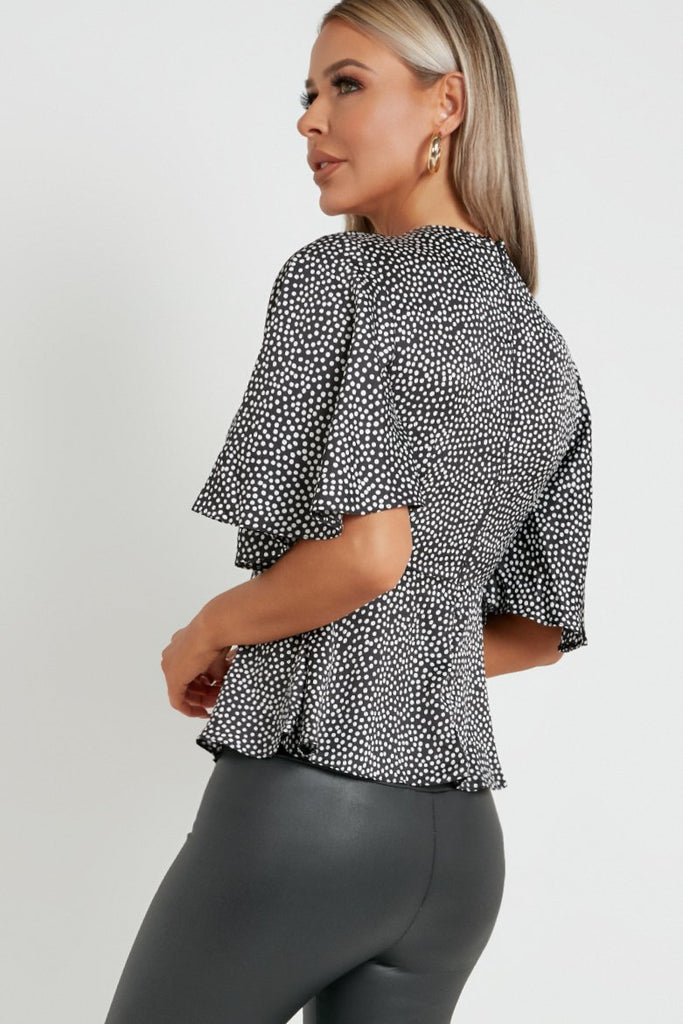 Nia Black Spotty Flared Blouse