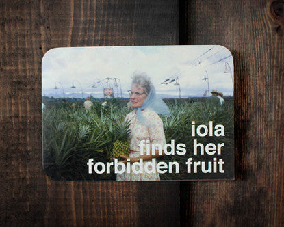Retro Greeting Card 1960's Image-woman in blue scarf with pineapple in pineapple field. Text- Iola Finds Her Forbidden Fruit