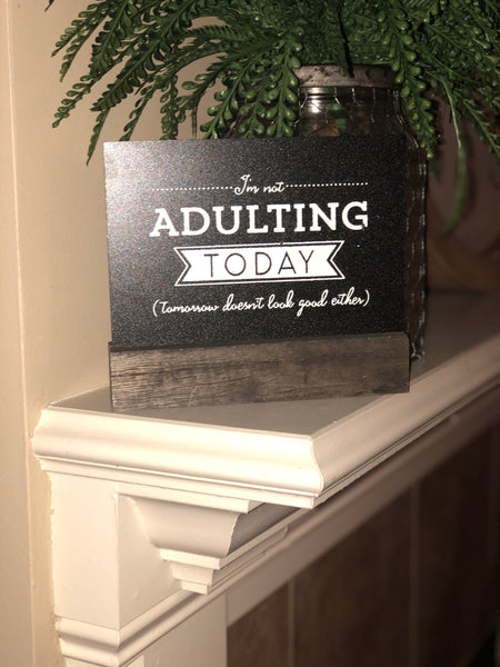 "Wooden stand with ""I'm not adulting today"" chalkboard"""