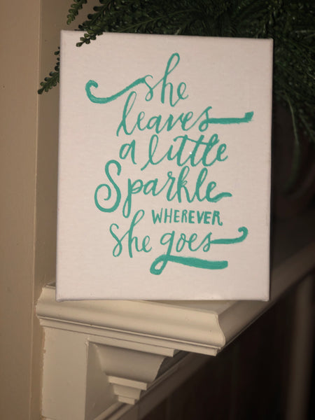 """She leaves a little sparkle"" canvas sign"