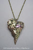 Harlequin&Lionhead handmade feather wings heart statement pendant necklace in brass
