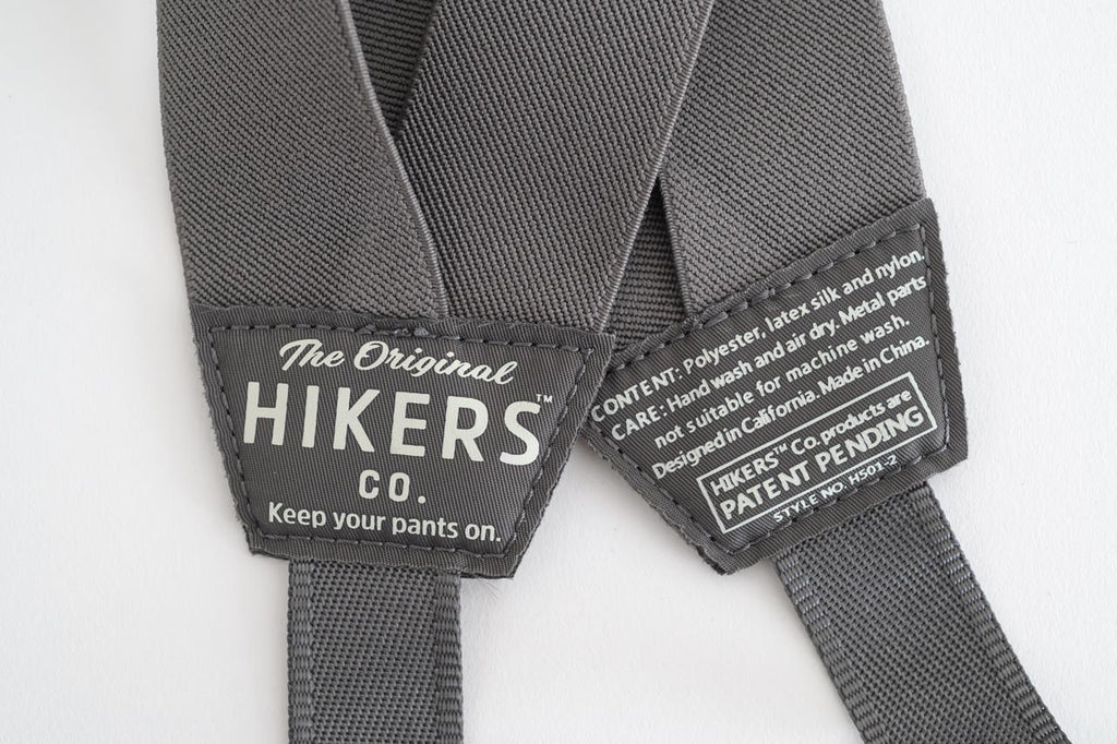 Closeup of HIKERS suspenders for men and women in gray