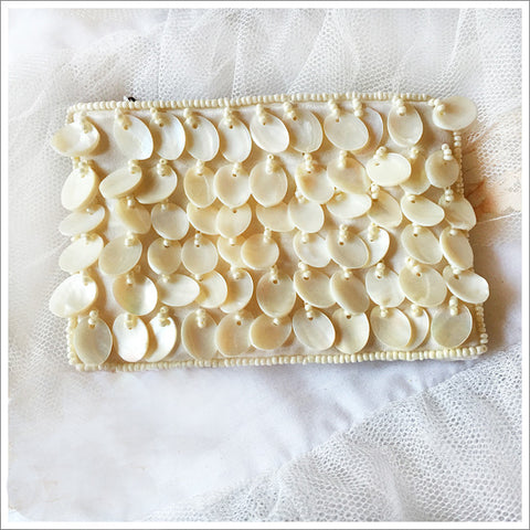 Darling little coin purse. Ivory satin covered in mother-of-pearl with a zipped closure.