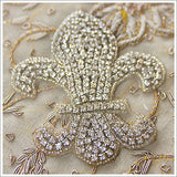 "Rhinestone fleur-de-lis appliqué. Large at approximately 6"" high, and dyed for a vintage look."