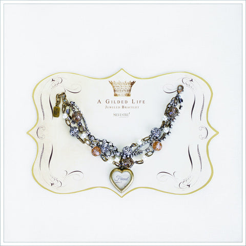 Multi strand jeweled bracelet with Friend heart charm.
