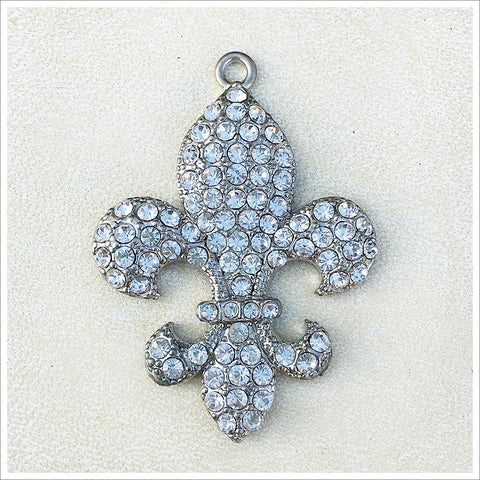 Stunning fleur de lis pendant, cast in a silver finish and encrusted with sparkly rhinestones