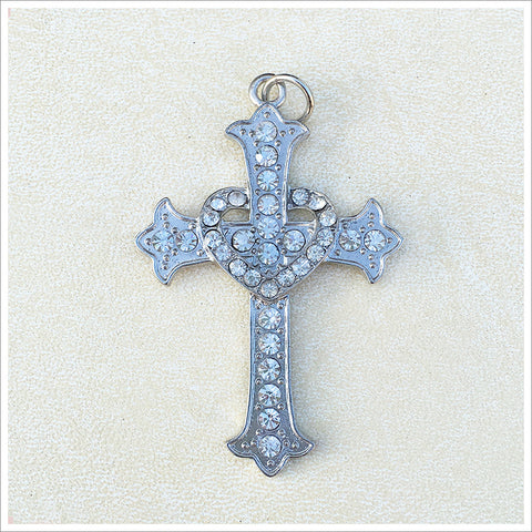 Lovely large cross and crown pendant, cast in a silver finish and encrusted with sparkly rhinestones.