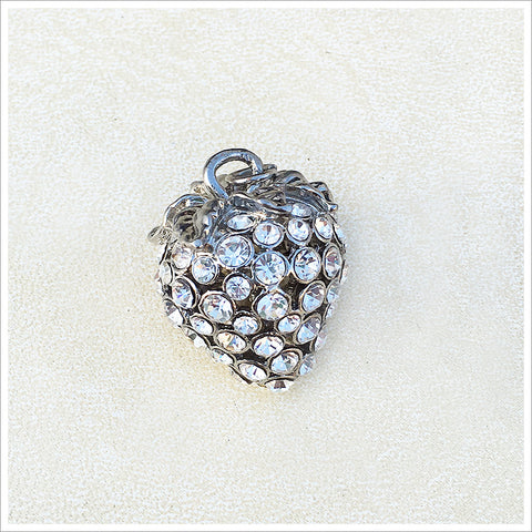 Lovely three-dimensional strawberry pendant, cast in a silver finish and encrusted with sparkly rhinestones.