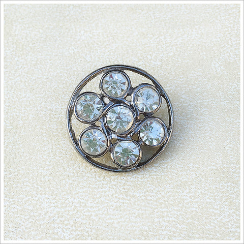 Openwork wire and rhinestone button featuring seven large stones in an antiqued setting.