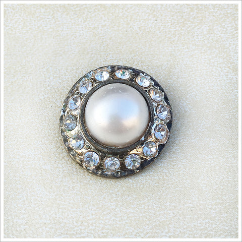 Vintage pearl and rhinestone button in an antiqued setting.