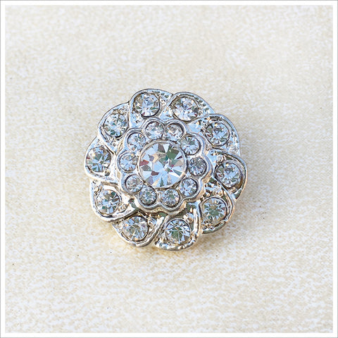 Beautiful rhinestone button in a heavy rhodium plated setting.
