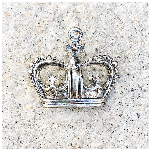 Unusual and beautiful crown charm, with it's large oval shape and antiqued silver tone.
