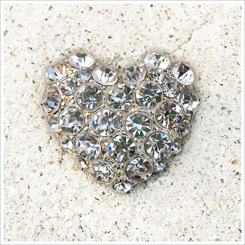 Lovely, classic heart pin brooch covered in rhinestones.