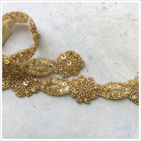 Gorgeous gold beaded applique/trim piece, accented with sequins. Lovely flower and leaf design, which would be perfect for cutting apart.