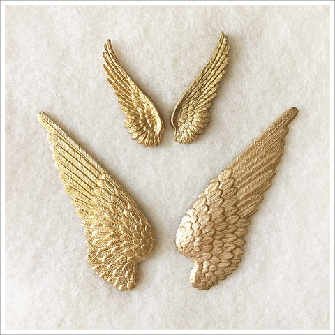 Set of stamped brass wings, heavy and beautifully detailed.