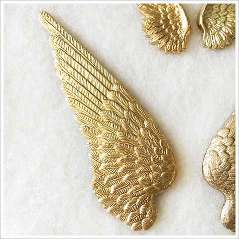 Set of stamped brass wings, heavy and beautifully detailed. These are gorgeous!