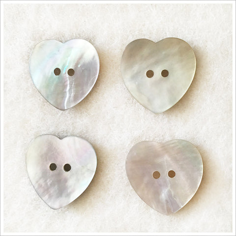 Set of large heart shaped abalone shell buttons. Set of four.