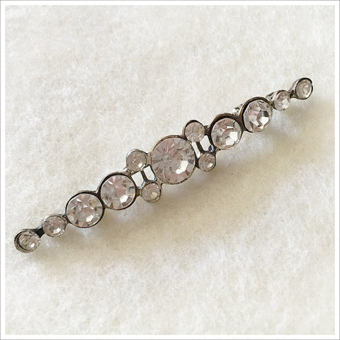 Vintage brooch. Silver toned setting with large rhinestones.