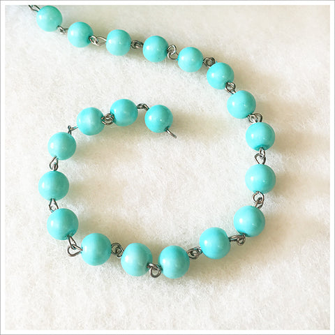 Gorgeous, soulful, pale blue rosary chain. Glass beads dyed to a gorgeous turquoise shade. 8mm.