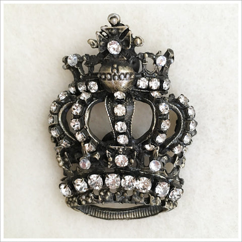 Large crown brooch, silver-toned or antiqued bronze metal, and finished with lots of sparkly rhinestones.