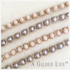 Woven bracelet in ballet pink faceted beads or lustrous glass pearls woven into an antiqued silver band.