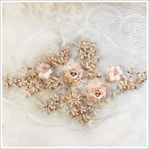 Exquisite appliqué featuring embroidered roses, beads, and rhinestones.