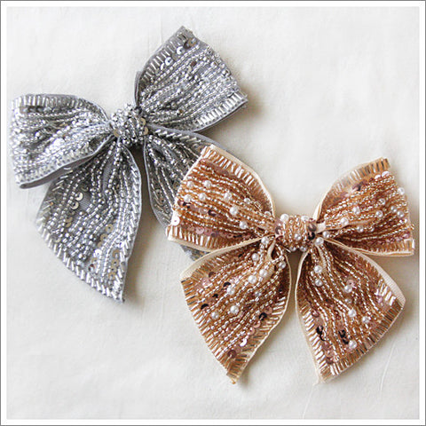 Heavy satin bows completely covered on the fronts with seed beads, sequins and pearls.