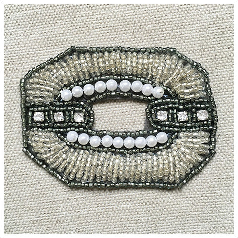 Vintage appliqué, lavished with pearls, rhinestones, along with gunmetal and silvery seed beads.