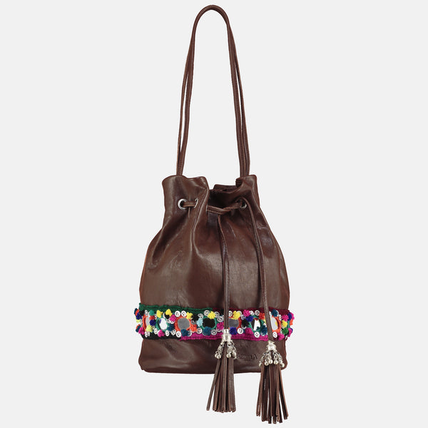 small bucket bag with metallic tribal tassles and  bright pom pom mirror belt detail
