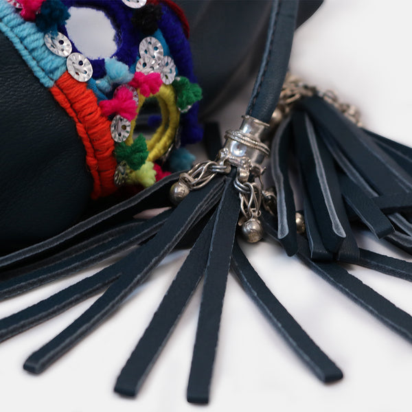 close up of tribal tassles and pompom mirrorwork