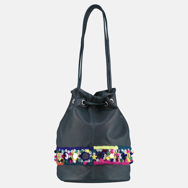 rear view of small tassled bucket bag in teal italian lamb nappa with silver metal tassles and  colourful pompom mirrorwork hand embroidery