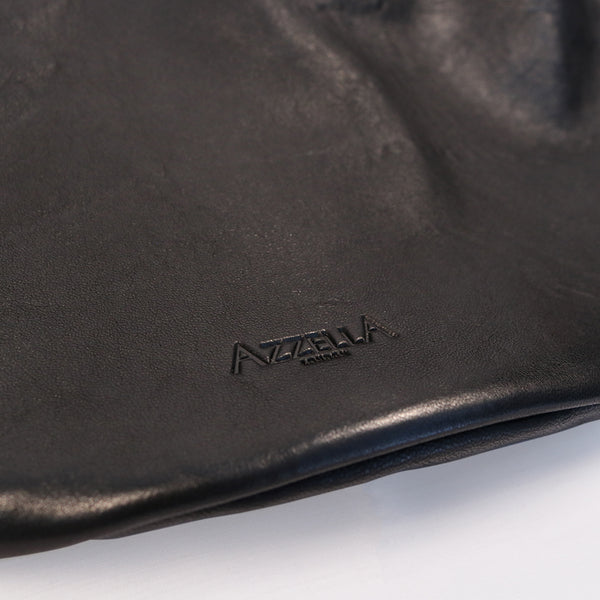 soft black leather shoulder bag handbag handmade close up detail