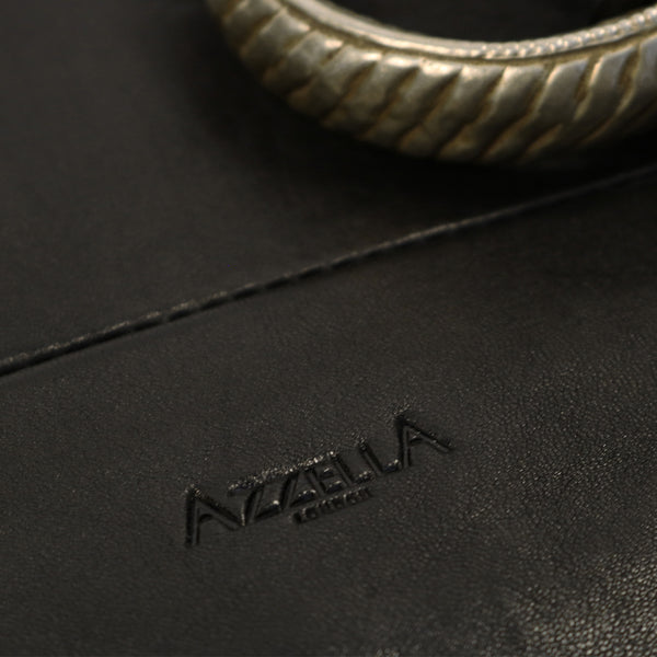 close up vintage bracelet and AzzellA logo on black leather