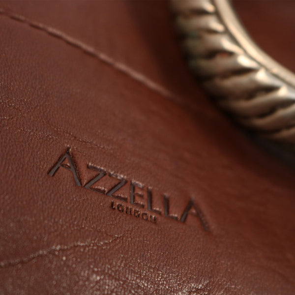 close up detail vintage tribal bracelet AzzellA logo on handmade handbag