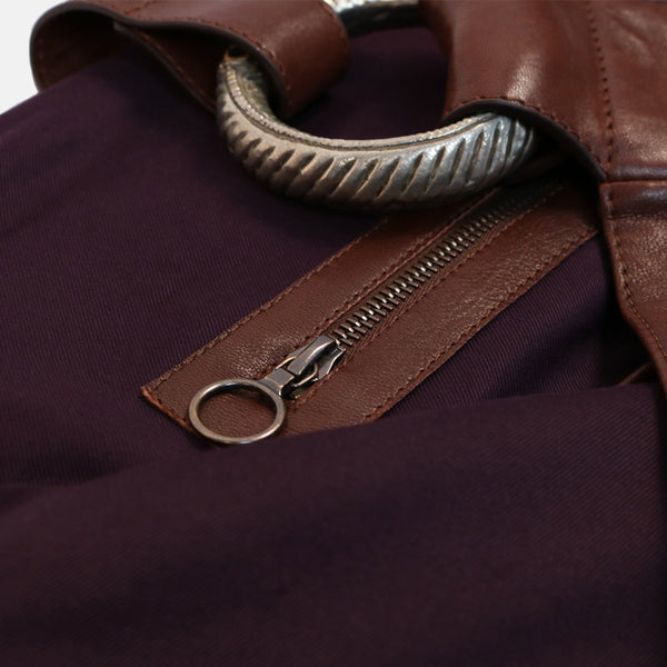 close up interior zip pocket and tribal jewellery detail. handmade veg tan leather shoulder bag