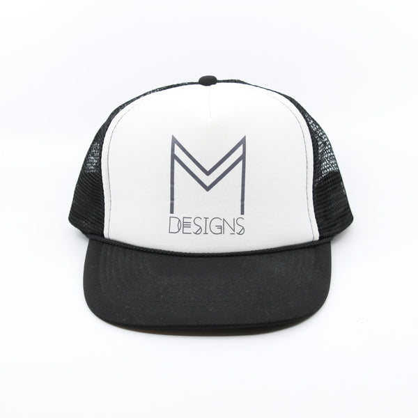 M Designs logo trucker hat black white