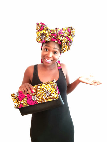 Happy woman wearing African prints headscarf earrings and bag
