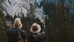 Two hikers pointing at a mountain, showing the nature we protect with our zero waste starter pack