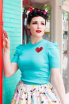 1940's vintage inspired knit top with a heart shaped sequin patch. Beautiful quality knit top, puffed sleeves.