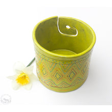 Load image into Gallery viewer, Tribal Print on Chartreuse Yarn Bowl - A Colorful Print in Orange, Red, Blue, & Green on a Yellow-Green Textured Glaze - Handcrafted Ceramic Yarn Bowl Crafted in Black Clay