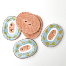 "Load image into Gallery viewer, Decorative Ceramic Button with Floral Print Border - Light Blue and Brown Clay Buttons - 1"" x 1 1/4"""