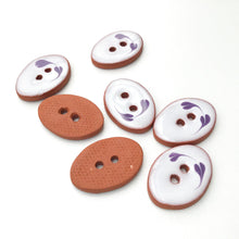 "Load image into Gallery viewer, Oval Ceramic Buttons - Hand Painted Clay Buttons with Small Flower Detail - White + Purple - 5/8"" x 7/8"" - 7 Pack"