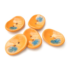 "Load image into Gallery viewer, Decorative Ceramic Button with Shimmery Color Drips - Orange - Blue - Oval Clay Button - 1"" x 1 1/4"""