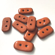 "Load image into Gallery viewer, Rust Colored Ceramic Buttons - Small Retangualr Clay Buttons - 3/8"" x 3/4"" - 9 Pack"